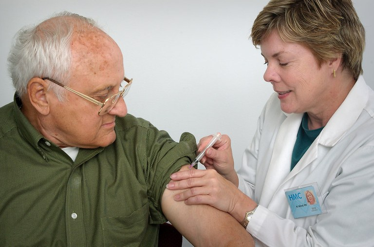 16729-a-nurse-giving-a-middle-aged-man-a-vaccination-shot-pv-freestockphotos-biz.jpg